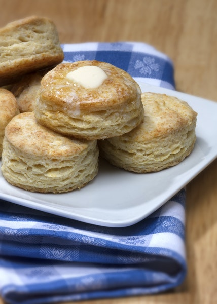 The buttermilk in these biscuits serves as the acid necessary to activate the baking soda in the ingredients. The liquid also adds extra flavor and he