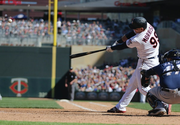 Minnesota Twins first baseman Logan Morrison (99) hits a two-run RBI against the Milwaukee Brewers in the eighth inning of a baseball game Sunday, May