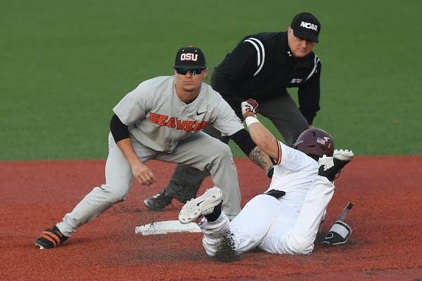 Oregon State shortstop Cadyn Grenier (2) tags out Minnesota's Ben Mezzenga (1)