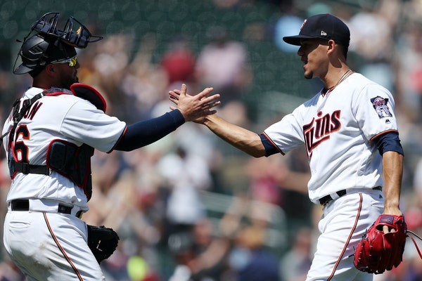 Twins starting pitcher Jose Berrios celebrated with catcher Bobby Wilson