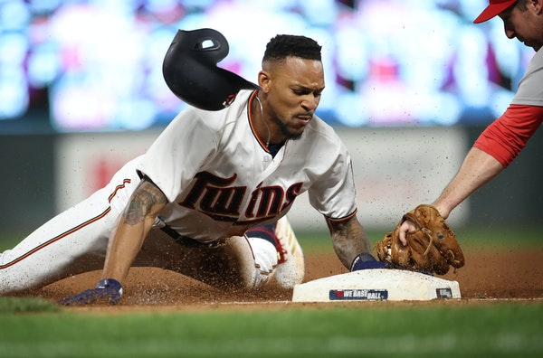 Byron Buxton stole third base in the seventh inning as St. Louis Cardinals third baseman Jedd Gyorko is late with the tag