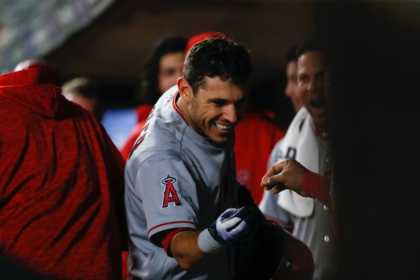 Angels second baseman Ian Kinsler celebrated in the dugout after hitting a two-run home run in the top of the seventh inning.