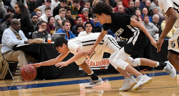 DeLaSalle guard Tyrell Terry (10) dove for a loose ball against Hopkins last season.