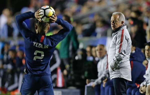 United States head coach Dave Sarachan watches DeAndre Yedlin (2) throw-in the ball during the second half of an international friendly soccer match a