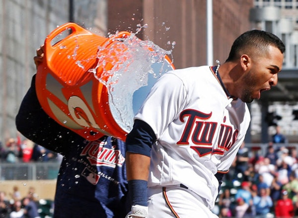 Minnesota Twins' Eddie Rosario gets a water dousing after his walkoff, two-run home run off Cleveland Indians' pitcher Cody Allen in the ninth inning