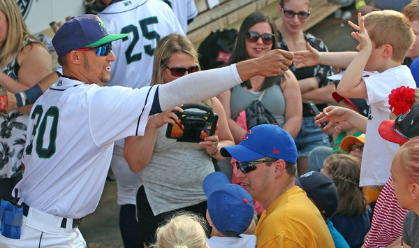 Royce Lewis met one of his many young fans at a recent Cedar Rapids Kernels game.