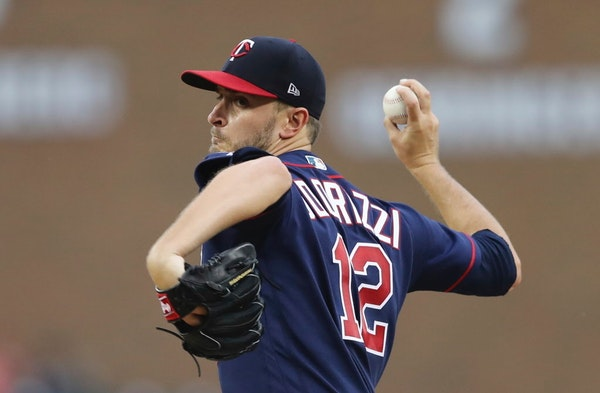 Minnesota Twins starting pitcher Jake Odorizzi throws during the first inning of the team's baseball game against the Detroit Tigers, Tuesday, June 12