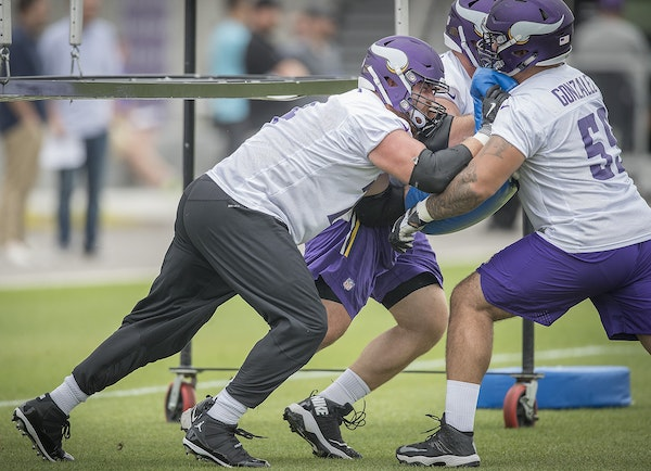 Vikings tackle Mike Remmers, left, took part in minicamp at the TCO Vikings Performance Center