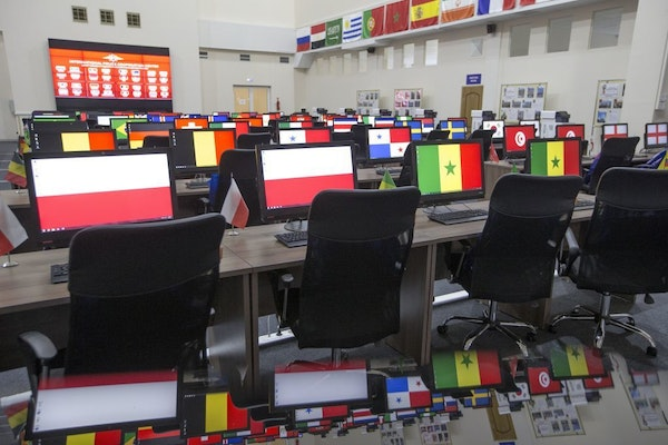 Computers' screens showing national flags of countries countries participating in World Cup 2018 at the main hall in the International Police Cooperat