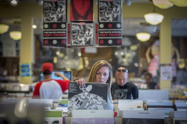 Morgan Tilgner made her way through the vinyl records section at Electric Fetus.