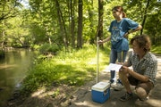 Will Bjorndal, a naturalist intern at he Jay C. Hormel Nature Center in Austin, made notes after he and fellow intern Andie Harveaux took a water samp