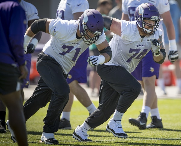 Vikings tackle Mike Remmers, right, ran drills on the field during a mandatory Vikings three-day minicamp at the TCO Performance Center, June 13, 2018