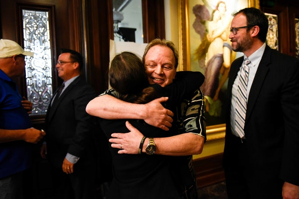 Childhood abuse survivor Jamie Heutmaker embraced bankruptcy attorney Brittany Michael after Thursday's news conference detailing the settlement reach