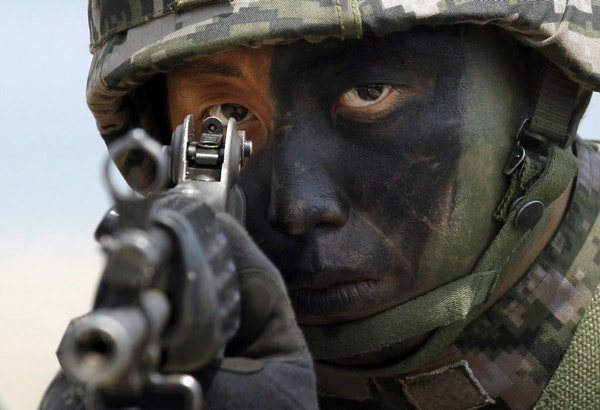 FILE - In this April 26, 2013 file photo, a South Korean Marine takes position during the joint military exercises between South Korea and the United