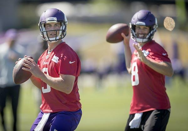 Vikings quarterback Trevor Siemian, left, ran drills alongside quarterback Kirk Cousins during a mandatory Vikings three-day minicamp in Eagan on Wedn