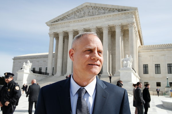 Andy Cilek stands outside of the Supreme Court, Wednesday, Feb. 28, 2018, in Washington, where a Minnesota law that bars residents from wearing politi