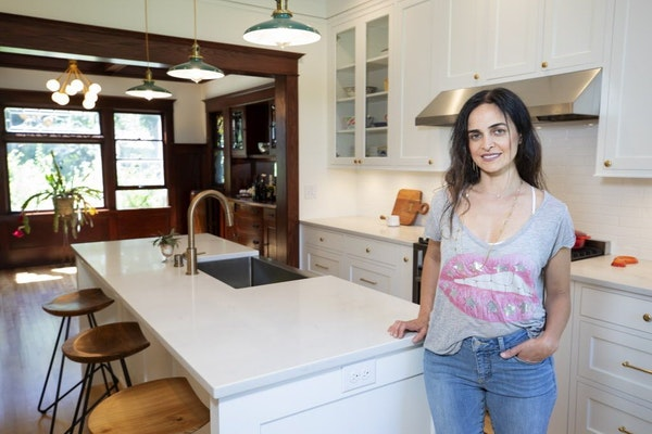 Homeowner Maryam Sarreshteh acted as the general contractor to revitalize and update her 1910 Arts & Crafts home. The light-filled spaces include a co