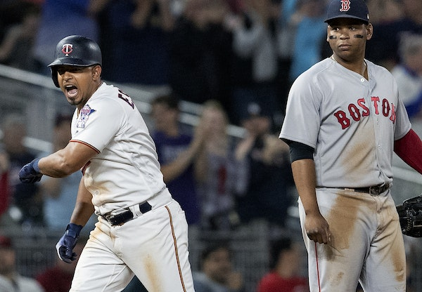 Minnesota Twins Eduardo Escobar reacted after safely sliding into third base in the eighth inning.