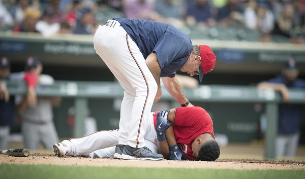 Twins Manager Paul Molitor ran out to check on Eduardo Escobar after he was hit by Red Sox pitcher Rick Porcello during the first inning as the Twins