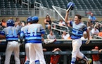 Heritage Christian Academy pitcher Seth Halvorsen, right, hit a three-run homer in the bottom of the fifth inning, his second of the game, against Sle