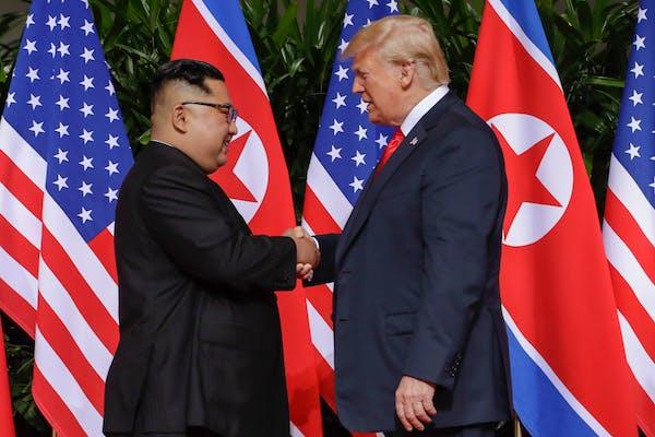 U.S. President Donald Trump shakes hands with North Korea leader Kim Jong Un at the Capella resort on Sentosa Island Tuesday, June 12, 2018 in Singapo
