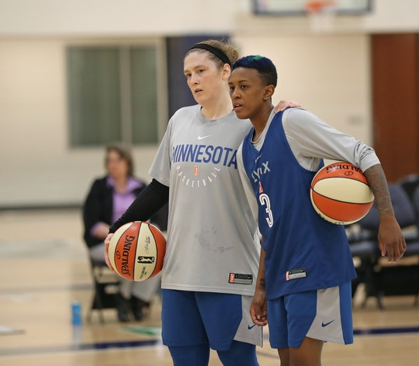 Minnesota Lynx point guards Lindsay Whalen and Danielle Robinson are sharing nearly equal minutes as Robinson has grown more comfortable with her new