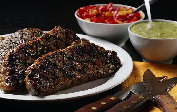 Put a combination of flavors and textures alongside grilled steaks with a creamy avocado-lemongrass sauce and a tomato-lemon relish.