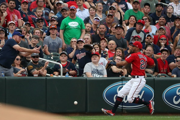 Twins left fielder Eddie Rosario chased down a ball hit by the Rangers' Shin-Soo Choo in the first inning