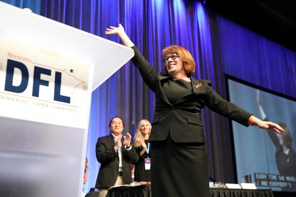 Rep. Erin Murphy smiled on stage after it was announced that the other candidates for governor were dropping out of the endorsement process at the DFL