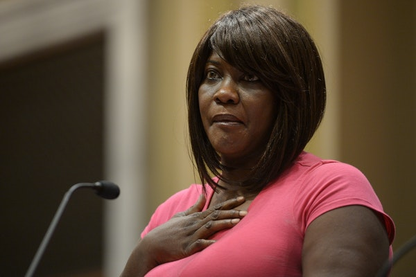 Minister Toya Woodland fought back tears as she made remarks concerning the Minneapolis Police Department's draft report on forced Ketamine use at Thu