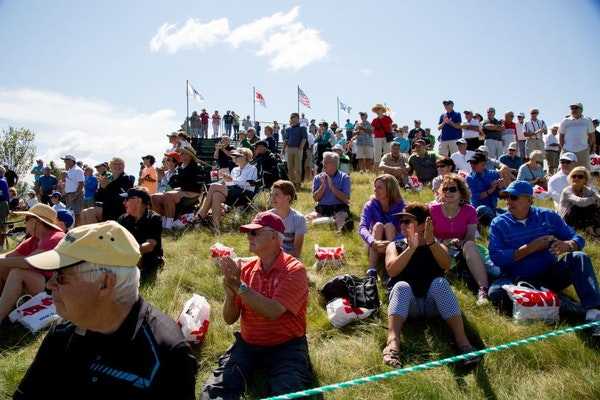 People watch golfers on the first tee at the 3M Championships in Blaine last year.