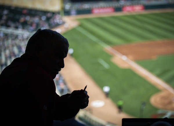 Stew Thornley, an official scorer for Twins games at Target Field, prepared to keep track of the first game of a doubleheader.