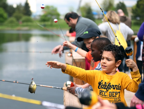 Various bodies of water in the Twin Cities area — the gathering above happened at Wolfe Lake in St. Louis Park — offer the sort of fishing that wi