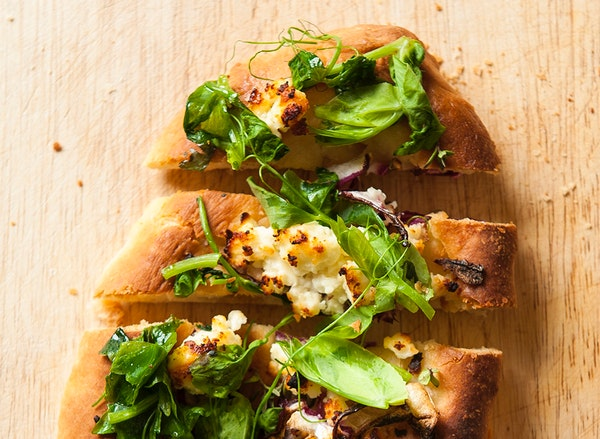 Naan With Red Onion, Feta and Pea Shoots.