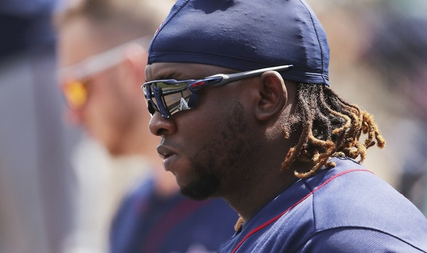 Miguel Sano sat in the Twins dugout on Thursday.