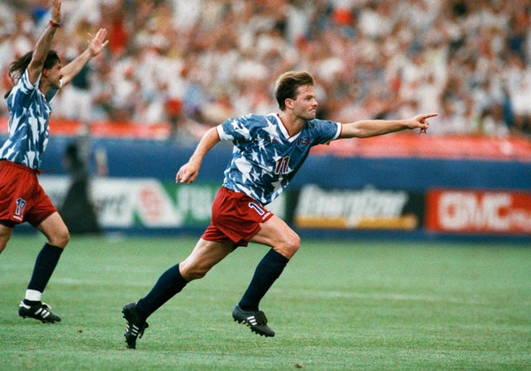 United States forward Eric Wynalda, right, reacts after he scored against Switzerland in a World Cup Group A first-round match at the Pontiac Silverdo