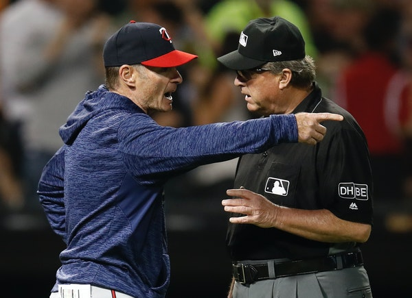 Minnesota Twins' manager Paul Molitor, left, argues with third base umpire Gerry Davis during the sixth inning