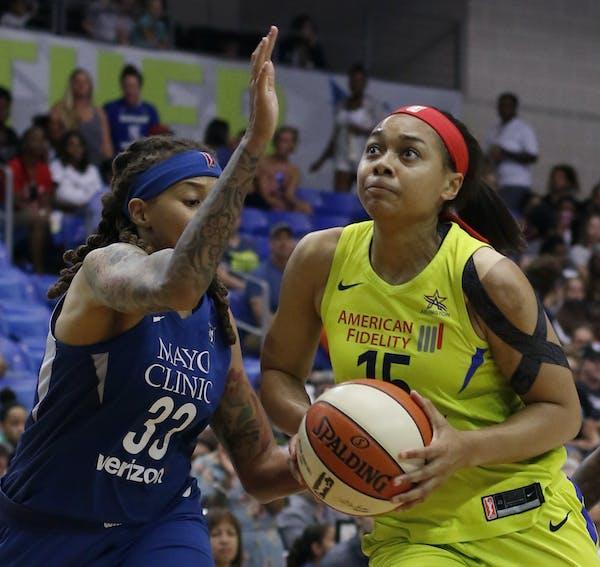 Dallas guard Allisha Gray drove to the basket past Lynx guard Seimone Augustus during the first half Sunday in Arlington, Texas.