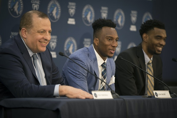 Wolves coach Tom Thibodeau with Josh Okogie, center, and Keita Bates-Diop, right, at Tuesday's news conference.
