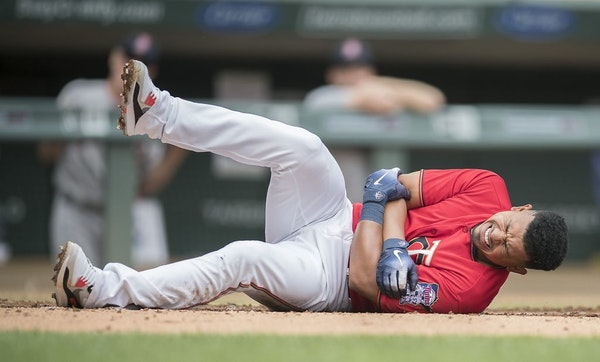 Eduardo Escobar goes down after he was hit by Red Sox pitcher Rick Porcello during the first inning as the Twins took on the Boston Red Sox at Target