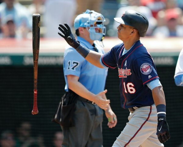 The Twins' Ehire Adrianza tossed his bat after striking out in the sixth inning against the Cleveland Indians on Sunday.