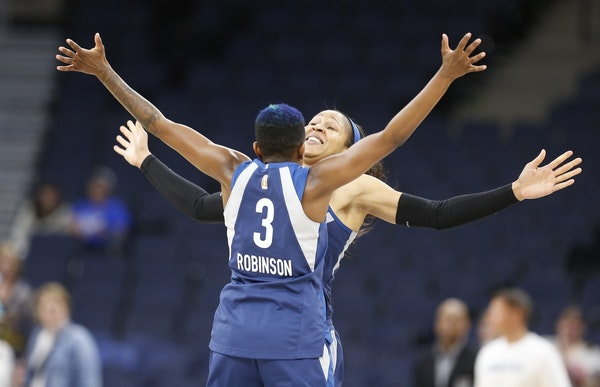 Minnesota Lynx players Maya Moore (23) and Lynx Danielle Robinson (3) celebrated after a game earlier this season. The Lynx defeated Phoenix on Friday