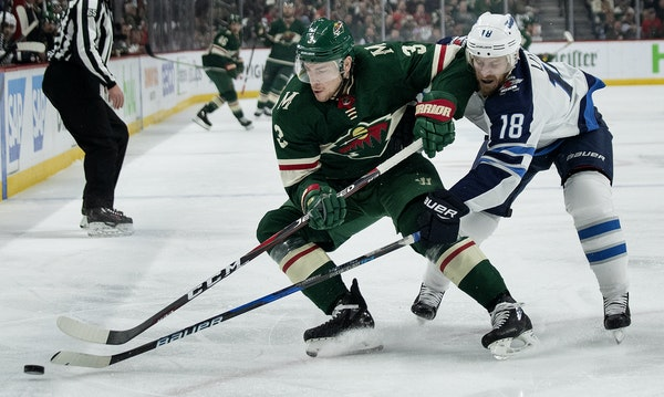 Charlie Coyle of the Wild and Bryan Little (18) of Winnipeg battled for the puck during the teams' April playoff series.