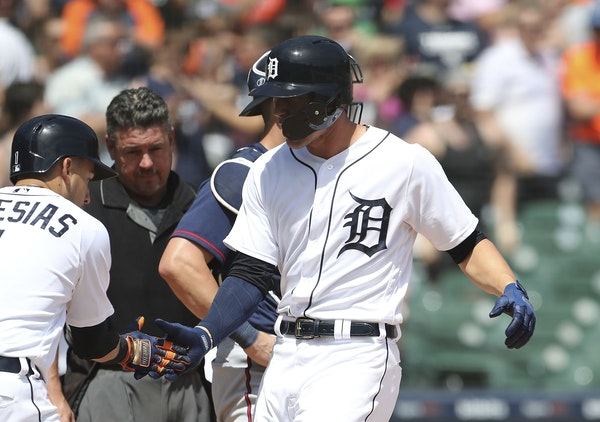 Detroit's JaCoby Jones (right) was greeted by Jose Iglesias (1) after hitting a two-run homer Thursday.