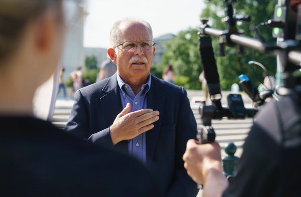 Illinois government worker Mark Janus talks during an interview before walking into the Supreme Court Building on Capitol Hill in Washington, Tuesday,