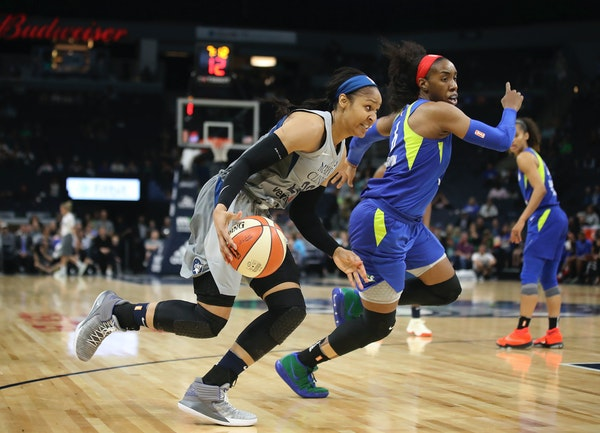 Maya Moore drove to the basket next to the Dallas Wings' Kayla Thornton on Tuesday.