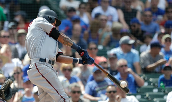 Twins shortstop Ehire Adrianza hit a two-run single off the Cubs' Tyler Chatwood during the top half of a very long fifth inning Saturday at Wrigley F