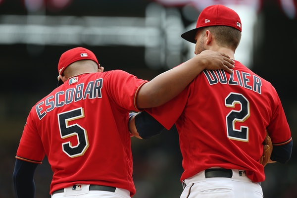 Infielders Eduardo Escobar, left, and Brian Dozier could be Twins players offered as trade possibilities as the deadline approaches. Escobar leads the