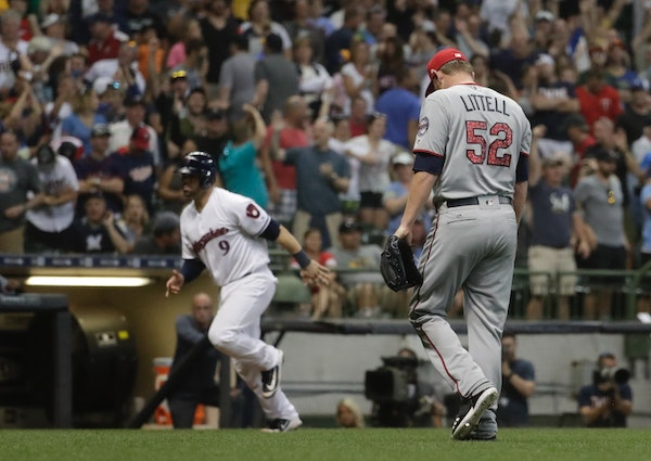 Twins reliever Zack Littell trudged back to the dugout as the Brewers' Manny Pina scored on a walkoff walk in the 10th inning Monday, giving Milwaukee