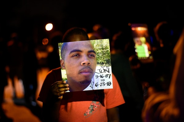 Isaiah Brown, 11, held a photo of Thurman Blevins, the man killed by Minneapolis police.